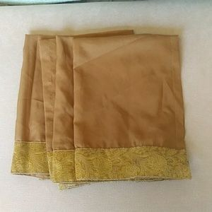 Set of four brown and gold satiny napkins